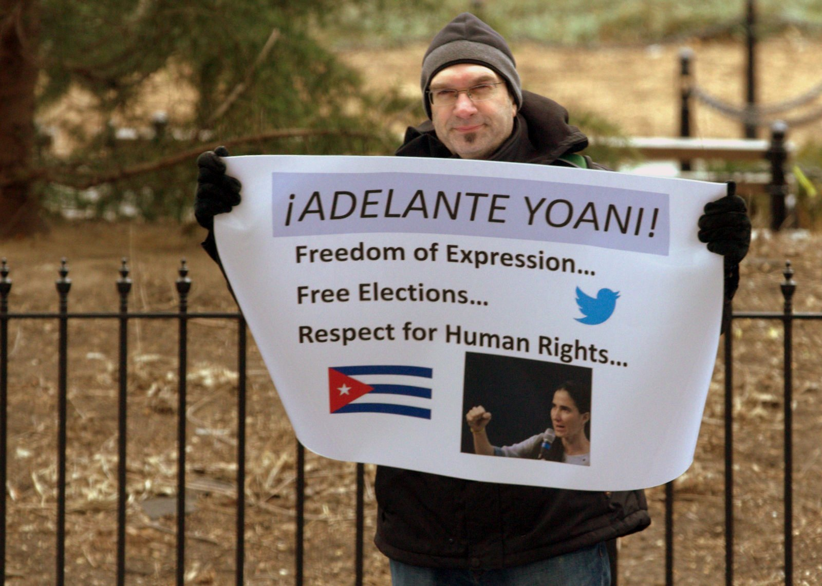 """This man stood outside New York University with a sign reading, """"Adelante Yoani!"""" which means, """"Onward Yoani!"""" By Tracey Eaton"""